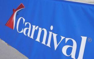 ASSOCIATED PRESS                                 A Carnival Cruise Line sign, seen Jan. 29, at PortMiami in Miami. Over two weeks in late July and early August, 27 coronavirus infections were identified aboard the Carnival Vista cruise ship sailing out of Galveston, Texas.