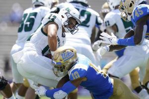ASSOCIATED PRESS / AUG. 28                                 Hawaii Warriors quarterback Chevan Cordeiro (12) is sacked by UCLA Bruins linebacker Ale Kaho (10) during the first half of an NCAA college football game in Pasadena, Calif.