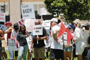 JAMM AQUINO / JULY 13                                 Protesters have been gathering outside of Lt. Gov. Josh Green's Honolulu condominium to object to state orders on the pandemic. Here they are at the corner of Alakea and South Beretania streets during a rally in support of the full reopening of the state.
