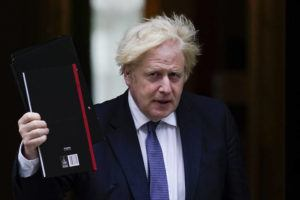 ASSOCIATED PRESS / AUG. 18                                 British Prime Minister Boris Johnson, seen here leaving 10 Downing Street last month, is expected to discuss the decision to scrap the vaccine passport idea Tuesday.