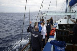 ASSOCIATED PRESS / SEPT. 3                                 French President Emmanuel Macron talks with the crew of the 7th Continent expedition sailing ship as they go admire the Calanques National Park, a marine reserve known for its azure blue waters overhung by high white cliffs, near Marseille, southern France. Macron is expected to urge the world to better protect biodiversity as key to fight climate change and support human welfare at a global summit starting Friday in southern France.