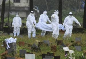 ASSOCIATED PRESS                                 People in protective suits prepared to cremate the body of a 12-year-old boy who died of the Nipah virus in Kozhikode, Kerala state, India, Sunday. The southern Indian state is quickly ramping up efforts to stop a potential outbreak of the deadly Nipah virus, even as it continues to battle the highest number of coronavirus cases in the country.