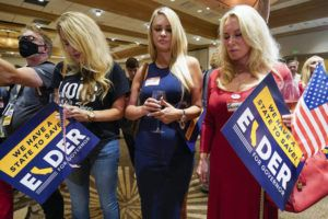 ASSOCIATED PRESS                                 Supporters of Republican conservative radio show host Larry Elder pray as polls close for the California gubernatorial recall election today in Costa Mesa, Calif.