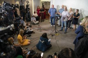 ASSOCIATED PRESS                                 Jim Schmidt, stepfather of Gabby Petito, whose death on a cross-country trip has sparked a manhunt for her boyfriend Brian Laundrie, speaks alongside Joseph Petito, father, immediate left, Tara Petito, stepmother, second from right, and Nicole Schmidt, mother, right, during a news conference in Bohemia, N.Y.