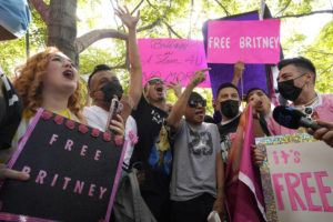 ASSOCIATED PRESS                                 Britney Spears supporters celebrate outside the Stanley Mosk Courthouse today in Los Angeles after a judge suspended Spears' father from the conservatorship that has controlled the singer's life and money for 13 years.