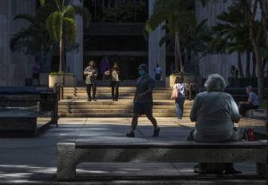 CINDY ELLEN RUSSELL / CRUSSELL@STARADVERTISER.COM                                 People strolled and relaxed at Bishop Square, Jan. 21, in downtown Honolulu.