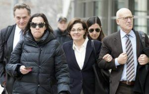 ASSOCIATED PRESS                                 Nancy Salzman, center, left Brooklyn Federal court, in March 2019, in New York. Salzman, co-founder of NXIVM, the embattled upstate New York self-help organization has pleaded guilty in a case featuring sensational claims that some followers became branded sex slaves.