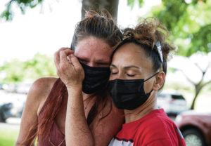 CINDY ELLEN RUSSELL / CRUSSELL@STARADVERTISER.COM                                 A massive search is underway in Waimanalo for 6-year-old Isabella Kalua, who was last seen Sunday evening in her home. On the second day of the search, volunteers fanned out from Waimanalo District Park in hopes of finding her. Kalua's biological mother, Melanie Joseph, left, was consoled Tuesday by her cousin Alena Kaeo.