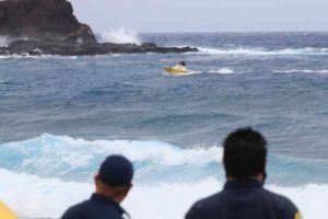 JAMM AQUINO / JAQUINO@STARADVERTISER.COM                                 A Honolulu Fire Department rescue boat and its crew navigate large waves near Makapuu Point today on the third day of search efforts for a 24-year-old man who was reportedly swept into the ocean.