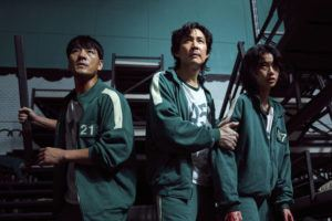 """YOUNGKYU PARK/NETFLIX VIA ASSOCIATED PRESS                                 South Korean cast members, from left, Park Hae-soo, Lee Jung-jae and Jung Ho-yeon in a scene from """"Squid Game."""" Squid Game, a globally popular South Korea-produced Netflix show that depicts hundreds of financially distressed characters competing in deadly children's games for a chance to escape severe debt, has struck a raw nerve at home, where there's growing discontent over soaring household debt, decaying job markets and worsening income inequality."""