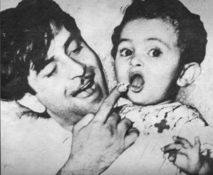 Baby Rishi Kapoor in the lap of his father Raj Kapoor