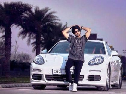 Diljit Dosanjh in front of his Porsche Panamera