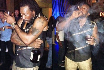 Chris Gayle smokes