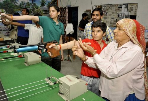 Chandro Tomar guiding youngsters for rifle shooting