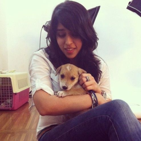 Ritika Sajdeh with a puppy
