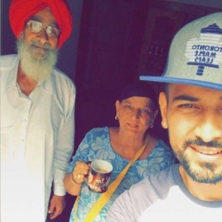 Garry Sandhu with his parents