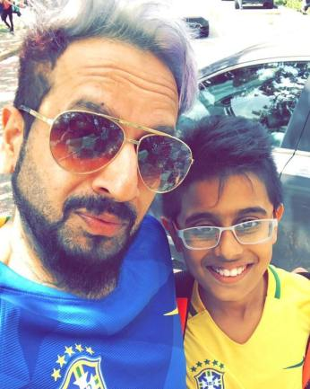 Jazzy B with his son