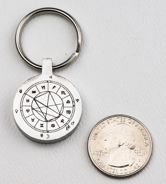 StarCharm personalized key fob compared in size to a US quarter