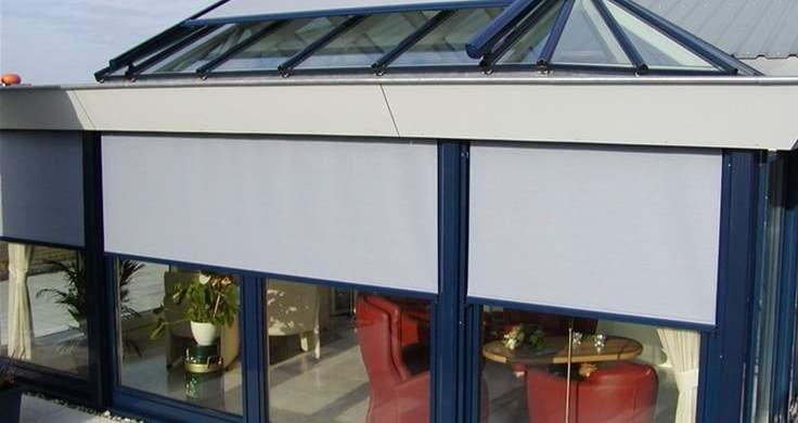 Windvaste screens en serrezonwering aan penthouse – Zwaag