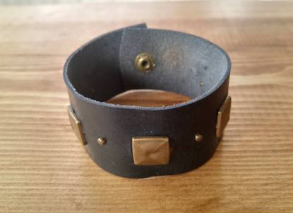 Bronze studded black leather cuff