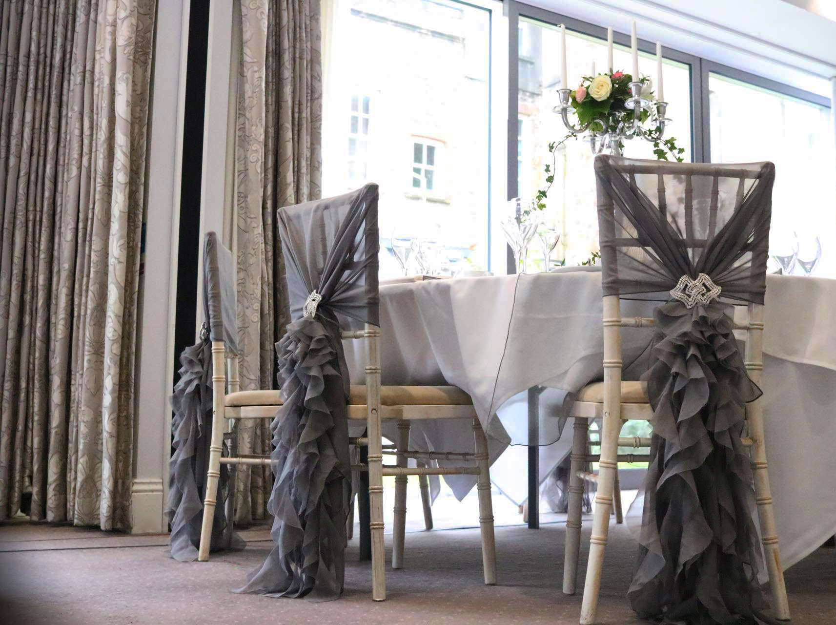 chair cover hire south wales beach clips target starlight events limewash chiavari with grey hood