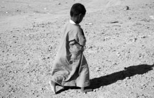 poor child walking
