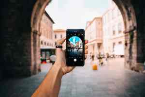 Arm holding a smartphone to take a picture