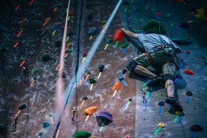Man rock climbing indoors