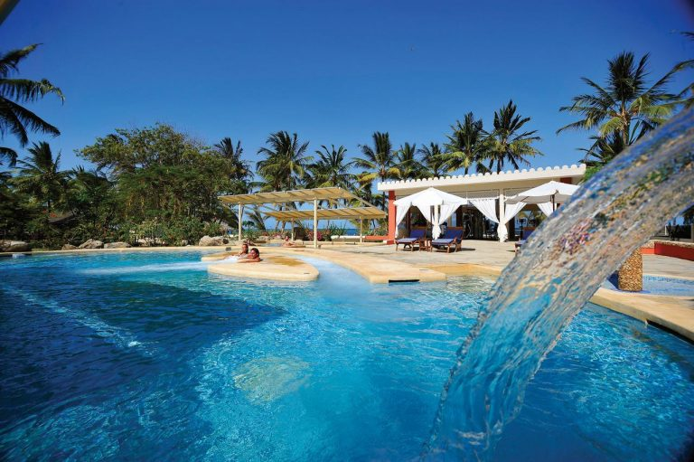 Swimming pool with a waterfall at Diamonds Dream of Africa.