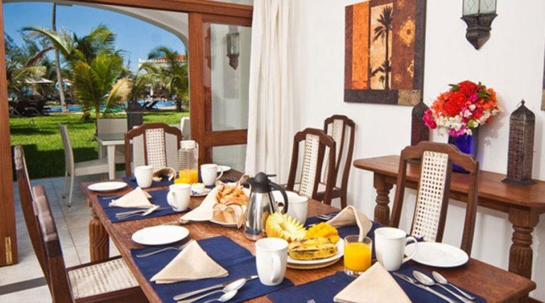 A set table at Lantana Galu Beach Resort