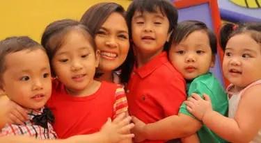 Judy Ann with Babies