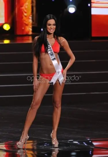 Ariella 'Ara' Arida with hair down in red swimsuit during the Preliminary Competition. Credit: OPMB Worldwide