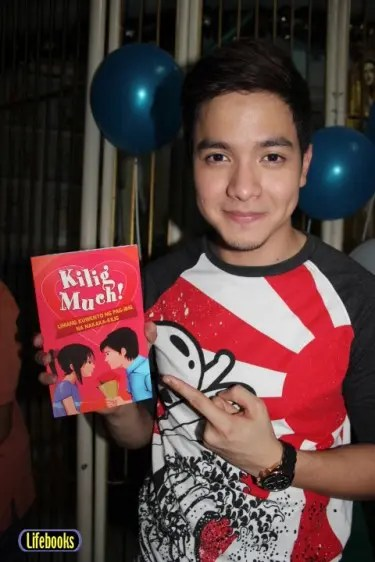 """""""Carmella"""" star Alden Richards with the book """"Kilig Much!"""""""