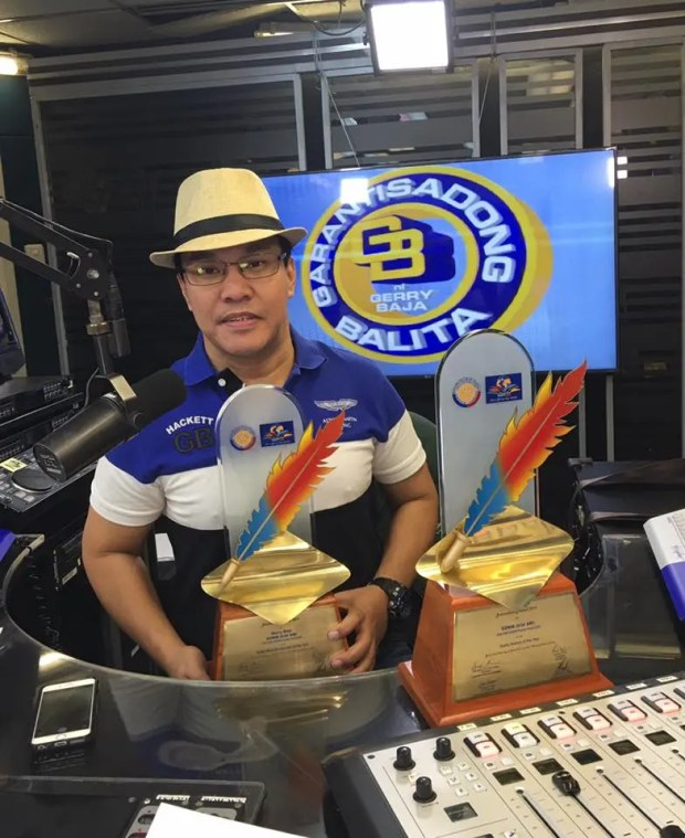 Gerry Baja poses with his new trophies after being named Radio Broadcaster of the Year by the Rotary Club of Manila.