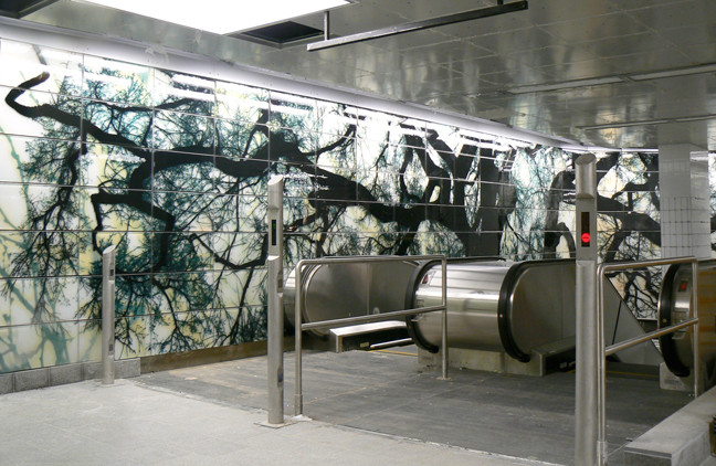Photo of tree installation in subway station.