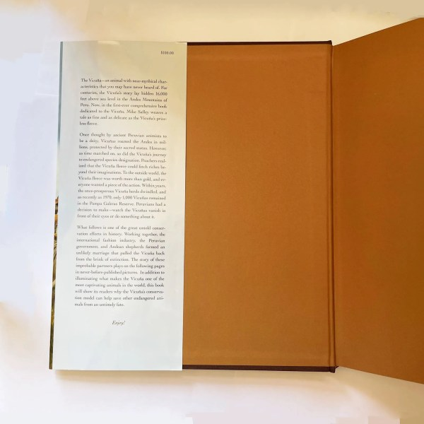 A book jacket has a trimmed edge at the top and bottom. It is standard, if you wish a dust jacket.