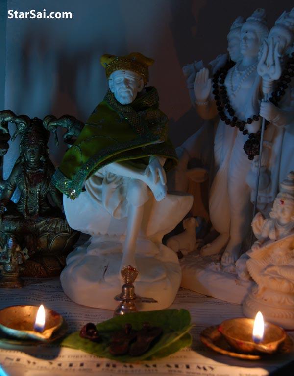 Shirdi Sai baba with beetle leave offering ,Mahalakshi , ganesha,saraswtai and datta