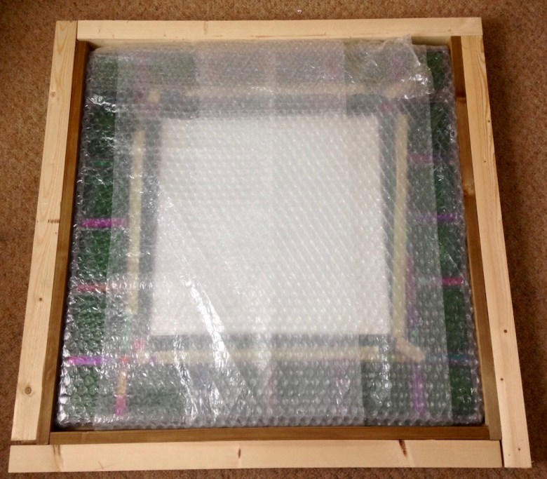 Handmade mirrors with green stained glass, leaded light border.