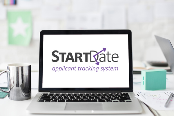 a laptop with startdate screen