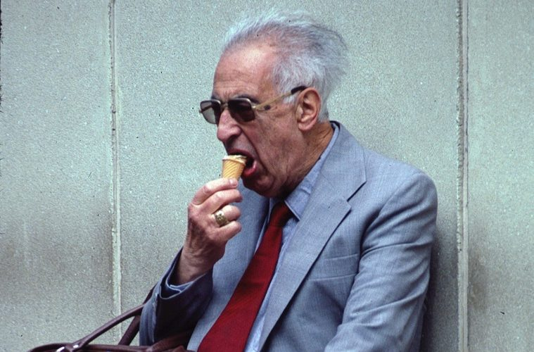 elderly man eating ice cream