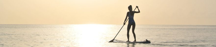 Paddle boarding In The Ocean