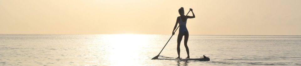 Paddle boarding In The Ocean