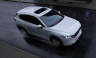 2022-mazda-cx-5-white-in-motion-1631627143