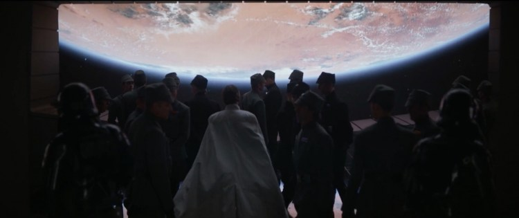 Director Krennic en een stel officieren met Jedha op de achtergrond.