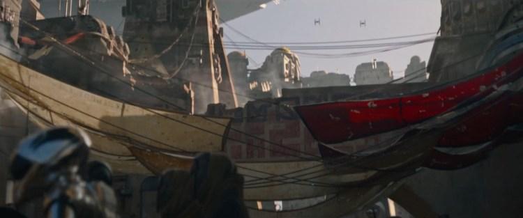 Hier zien we een shot van de stad op Jedha, op de voorgrond zien we vluchtig een RA-7 protocol droid en op de achtergrond zien we een AT-ST lopen, terwijl er TIE fighters over de stand heen vliegen. Ook zien we de Star Destroyer weer boven de stad zweven.