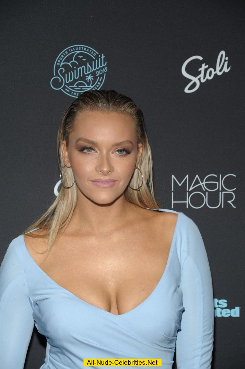 Camille Kostek sexy cleavage in blue dress