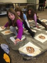 Troop 40429 gets ready for cookie sales by playing cookie twister.