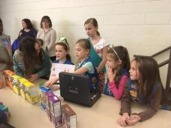 Troop 41123 practices running a cookie booth at the Cookie Rally.