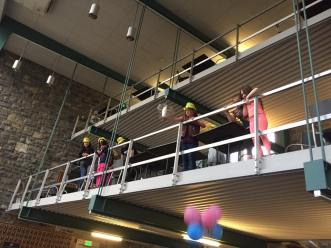Troop 40427 drops eggs off the balcony in Kunkle Lounge at the American Society of Civil Engineers Girls Day.
