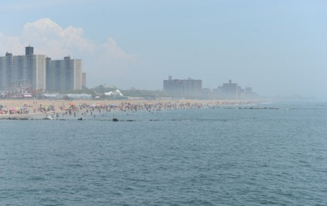 view from the water of people wading and swimming at Coney Island Beach.